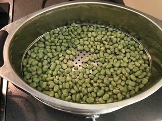 Broad beans ready for steaming