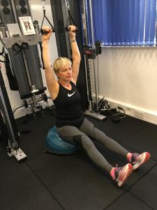 Client Nicola performing lat pulldowns