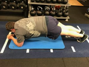 Client performing plank hold.