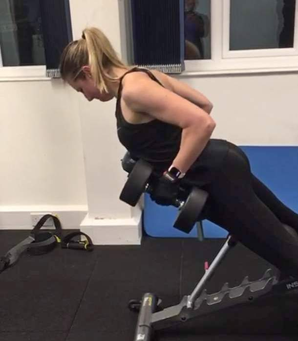 Woman performing bench rows. Bench rows are among the pick of exercises for your back