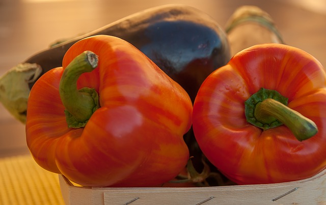 A picture of peppers and aubergine