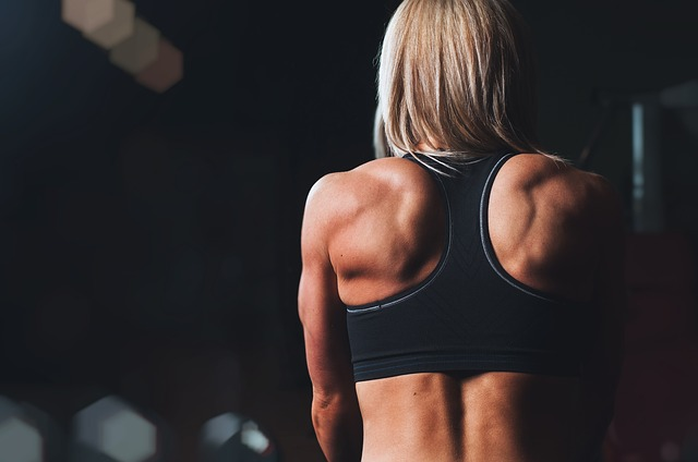 A picture of a girl's back at the gym