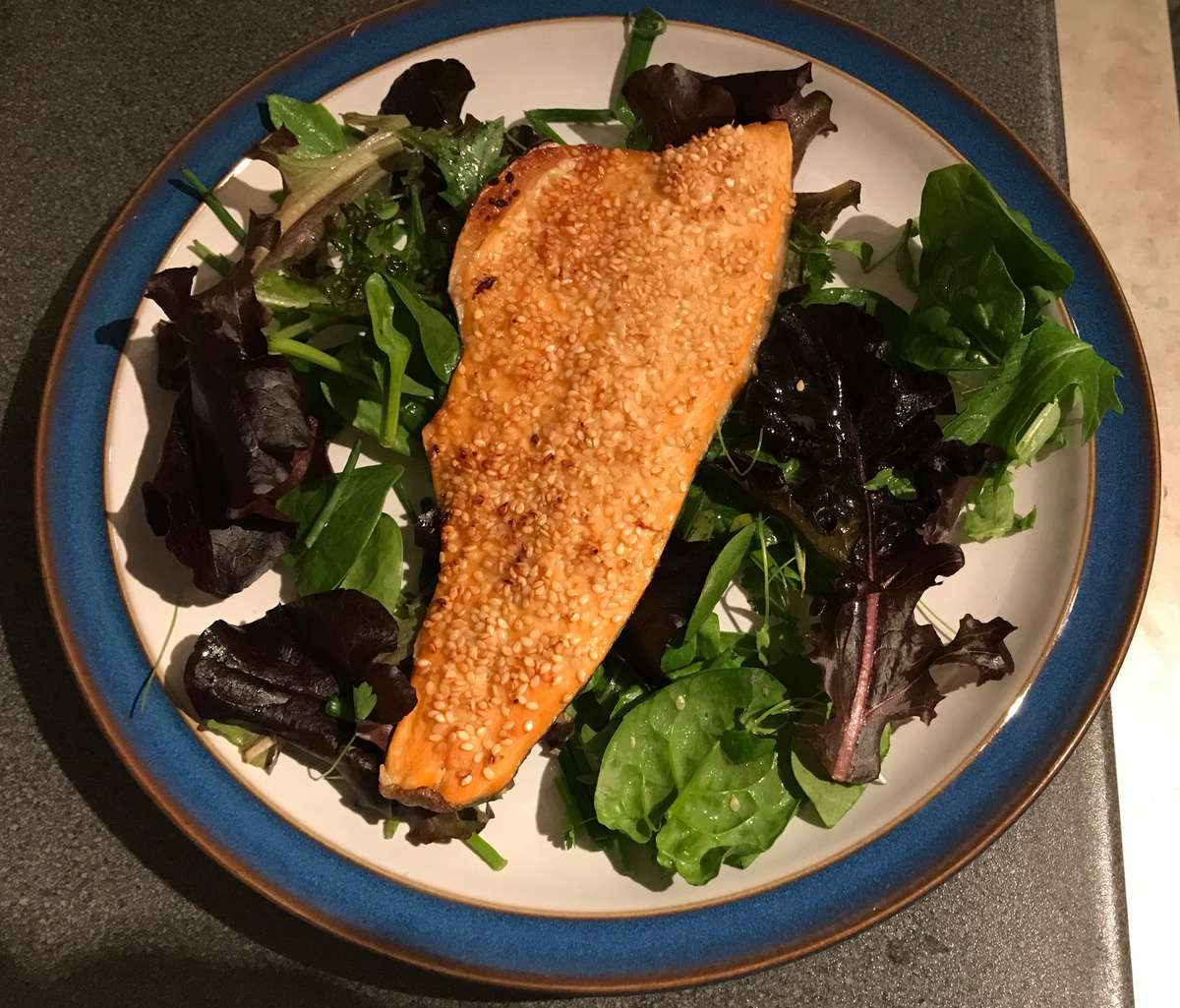 Sesame Trout served on a bed of herb salad leaves Should you become a pescatarian?