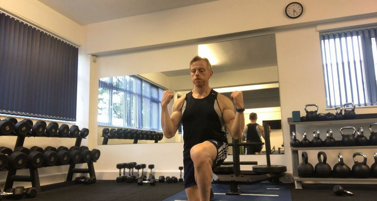 Are you ready to workout? man performing warm up drills