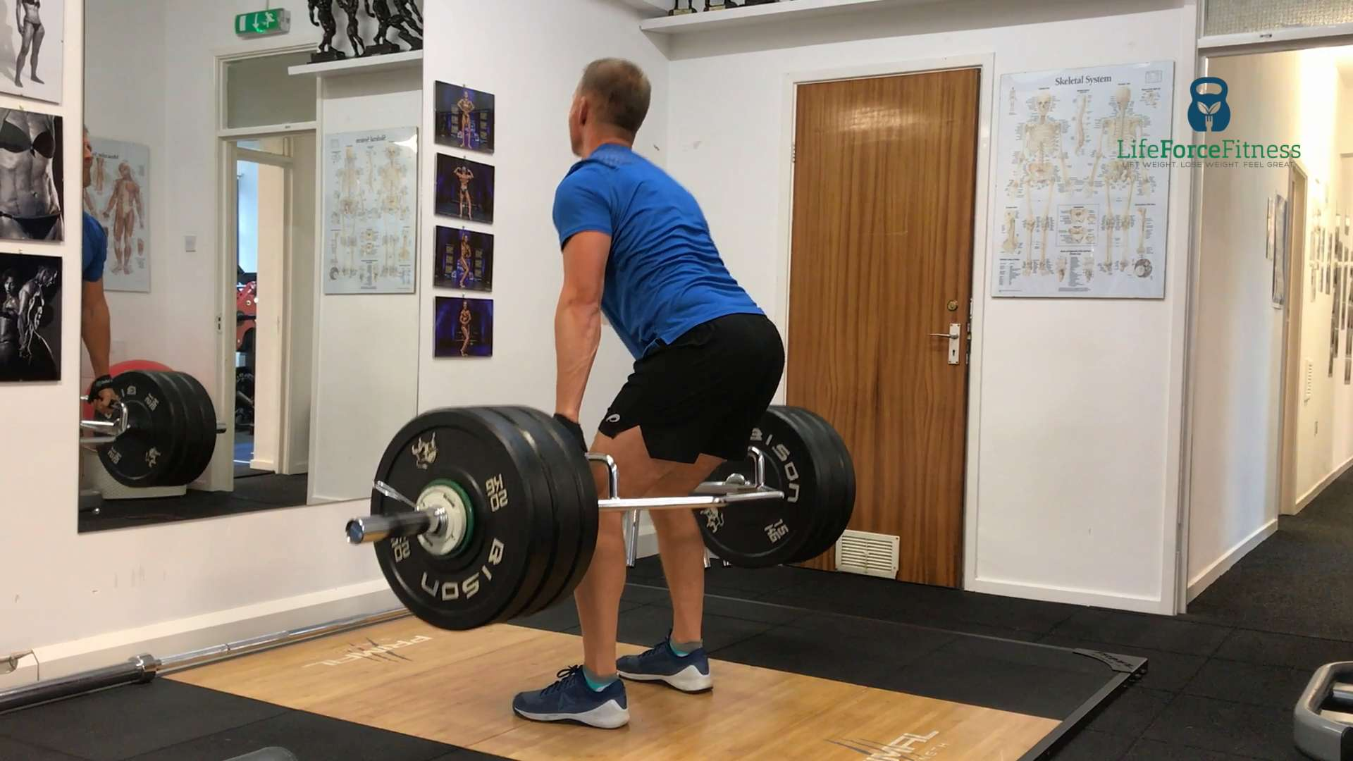 Client Dave midway through a 150kg deadlift with the hex bar. The deadlift is number one in the top 6 full body exercises.