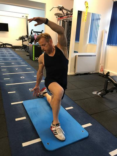 Psoas stretch being demonstrated by Jon