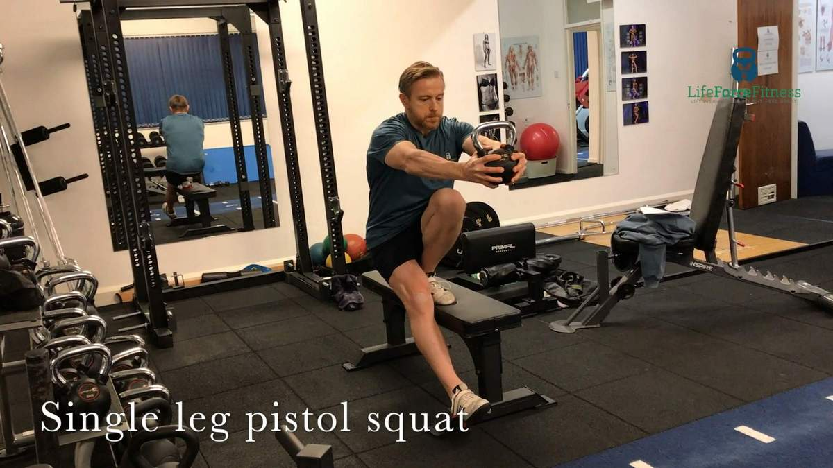 Single leg pistol squat, showing balanced strength