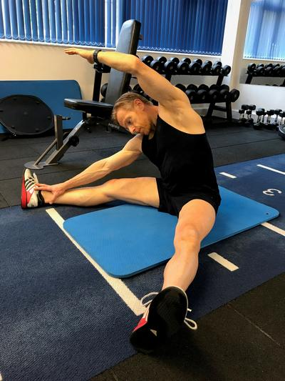 Jon doing lower back stretch for QLs. Top 10 tips for mature lifters