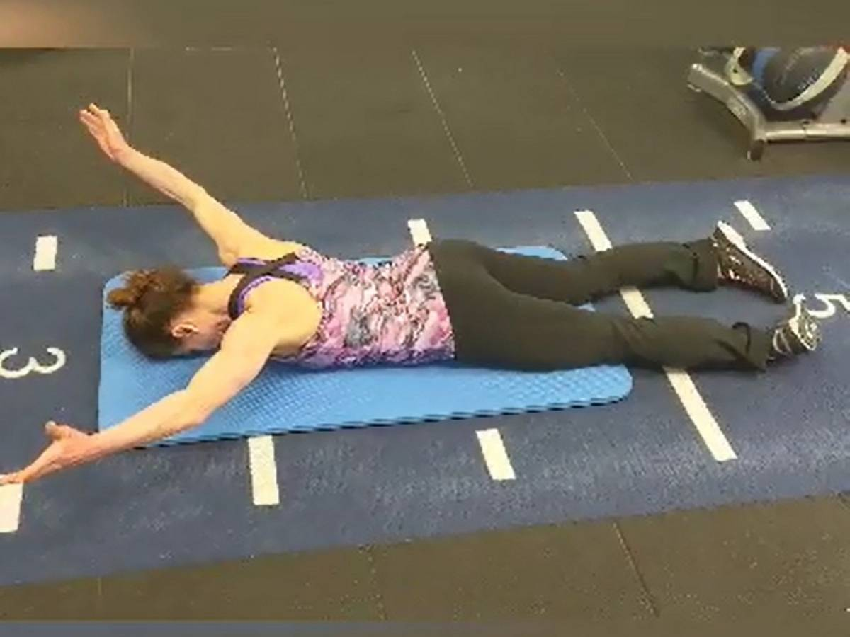 Trainer performing Y exercise