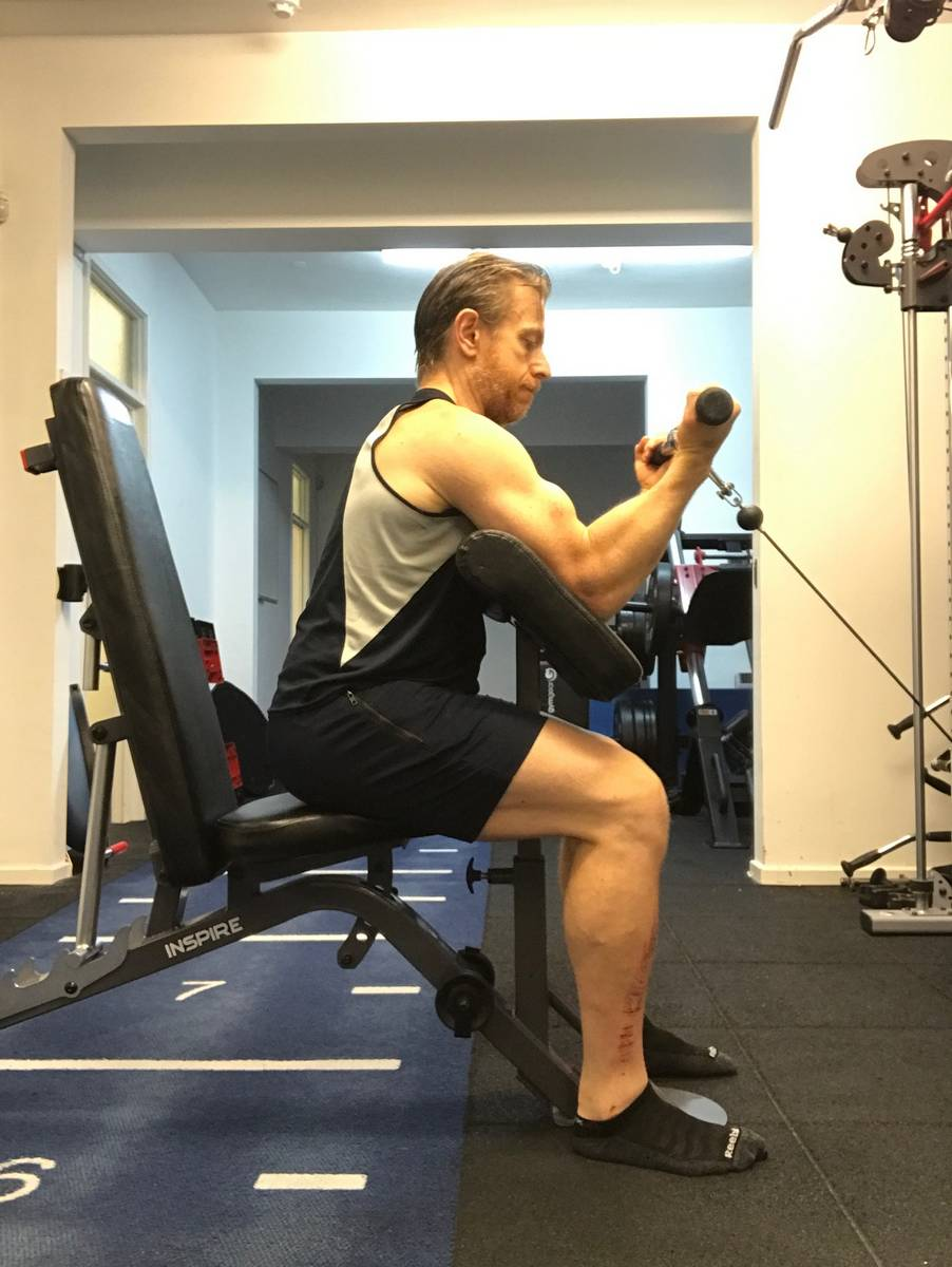 Cable preacher curl with cable angle set to match bench angle. In our view, the cable preacher curl is the most effective biceps exercise