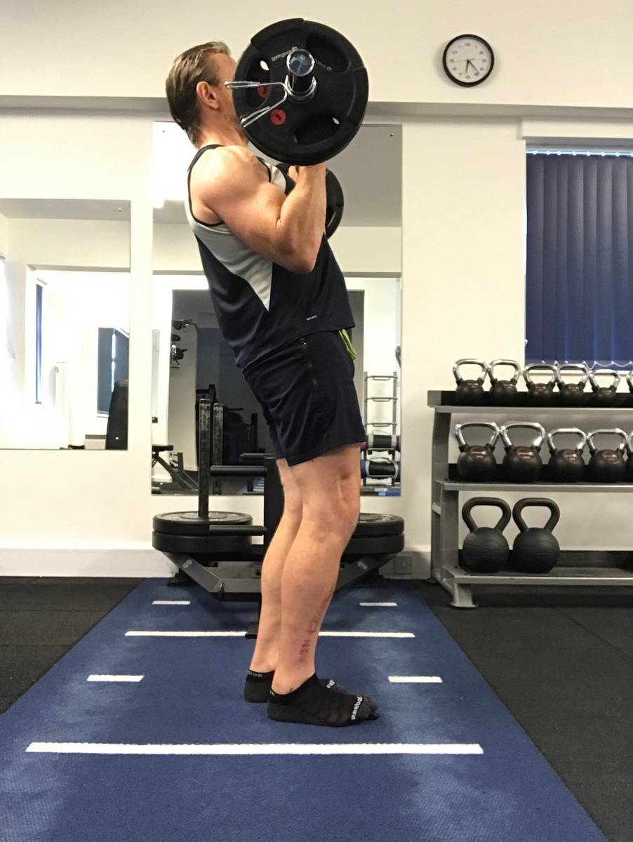 Leaning back in the standing biceps curl takes the load off the biceps