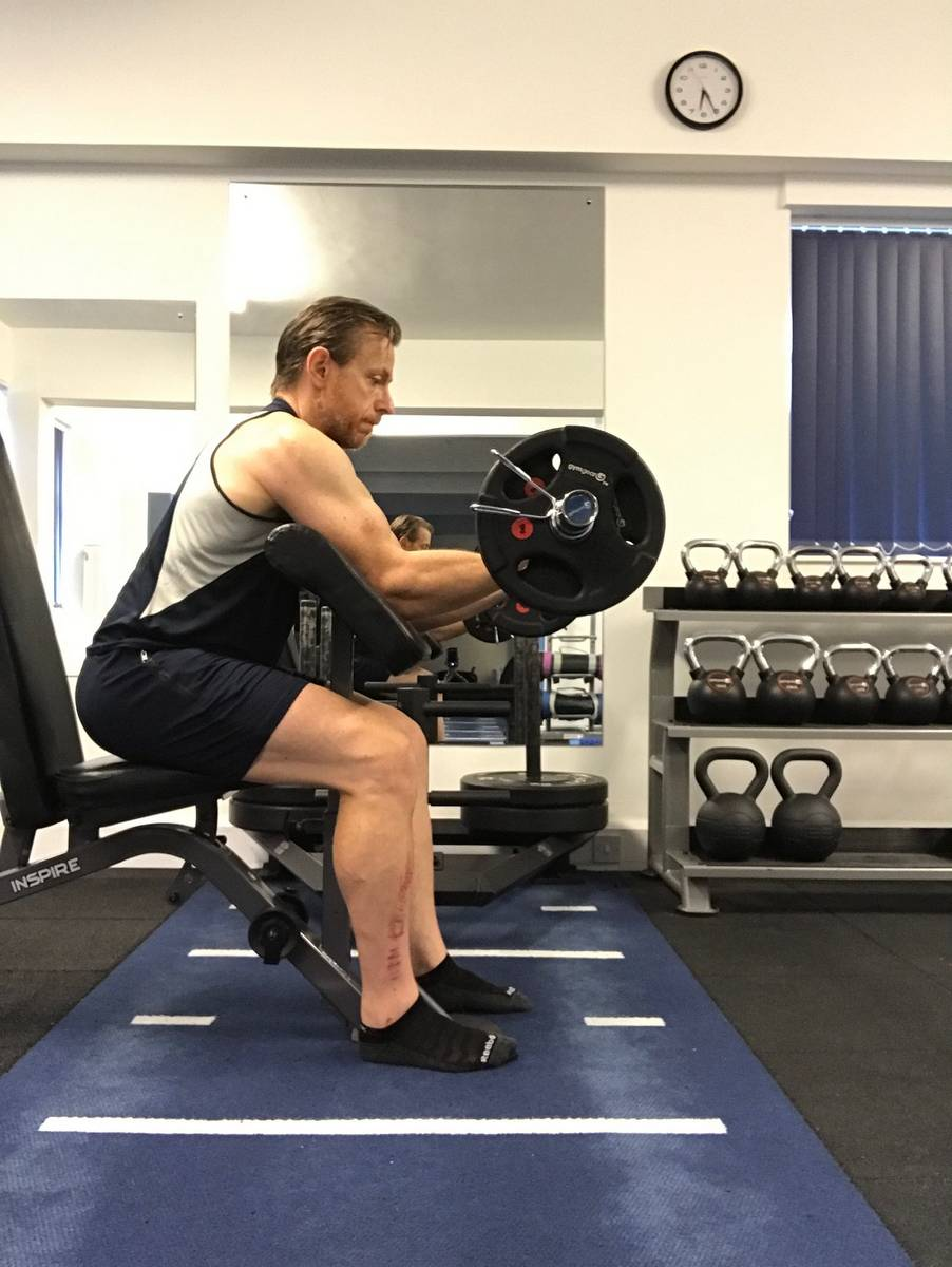 Standard preacher curl using a barbell. It's good, but it's not the most effective biceps exercise