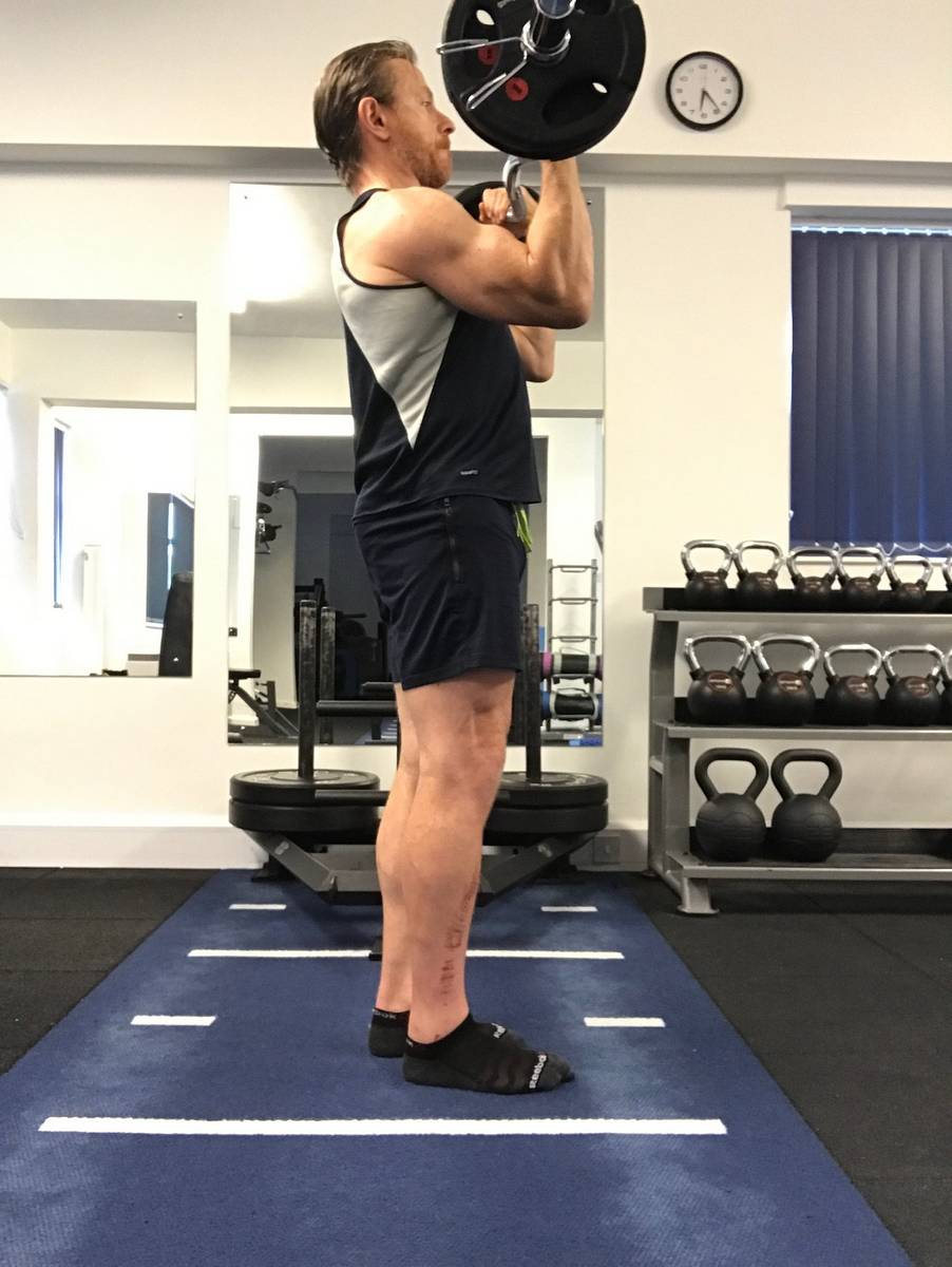 Lifting with the shoulders in the standing biceps curl takes the load off the biceps