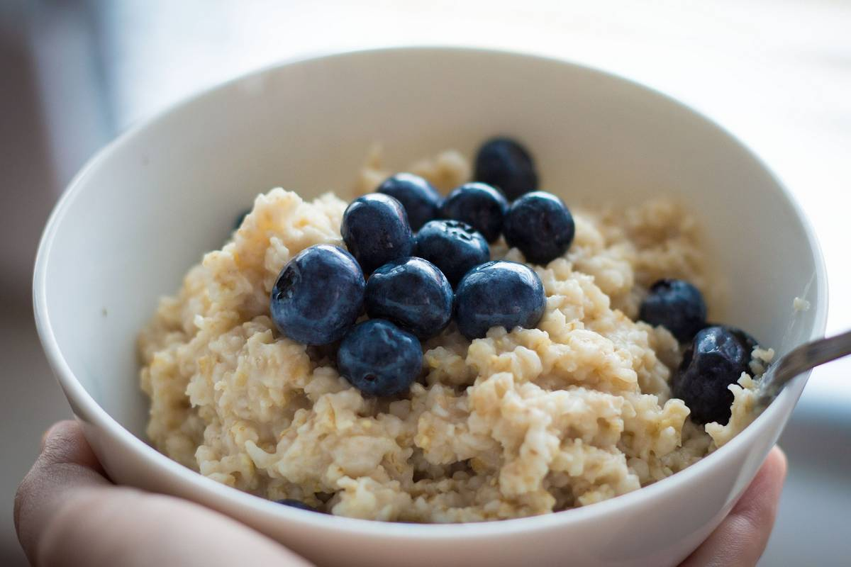 Close up of thick porridge with blueberries. Why it's important to have fibre in your diet