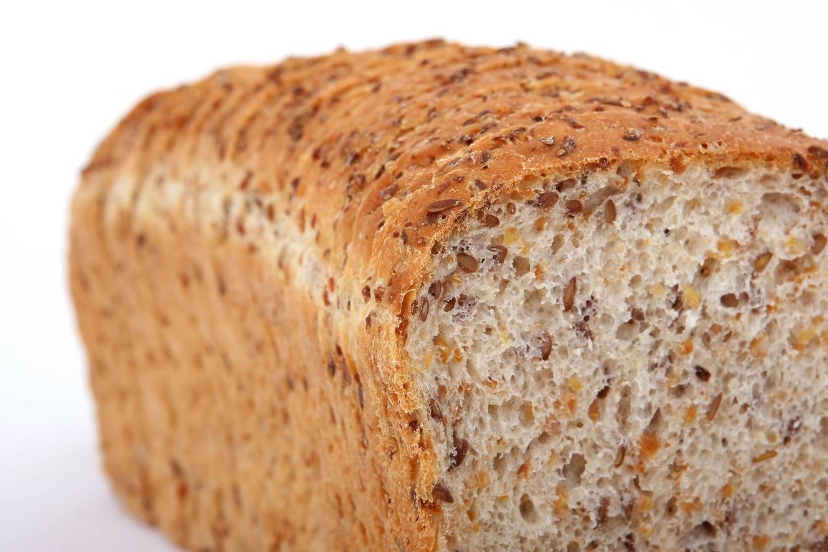 Close up of a wholegrain load with a slice taken off. Why it's important to have fibre in your diet