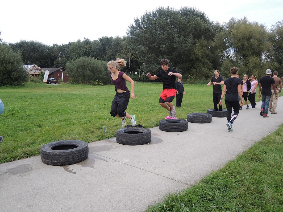 People taking part in a boot camp class, one option for what exercise programme should i choose
