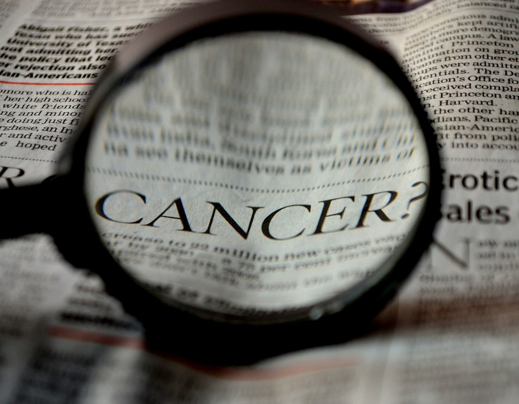 Newspaper page showing the word cancer
