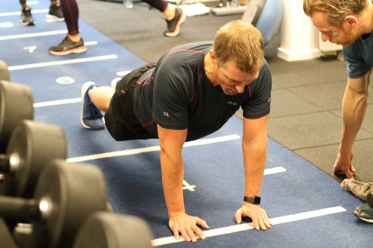 Client doing push ups. Heal your 'self' with an holistic approach