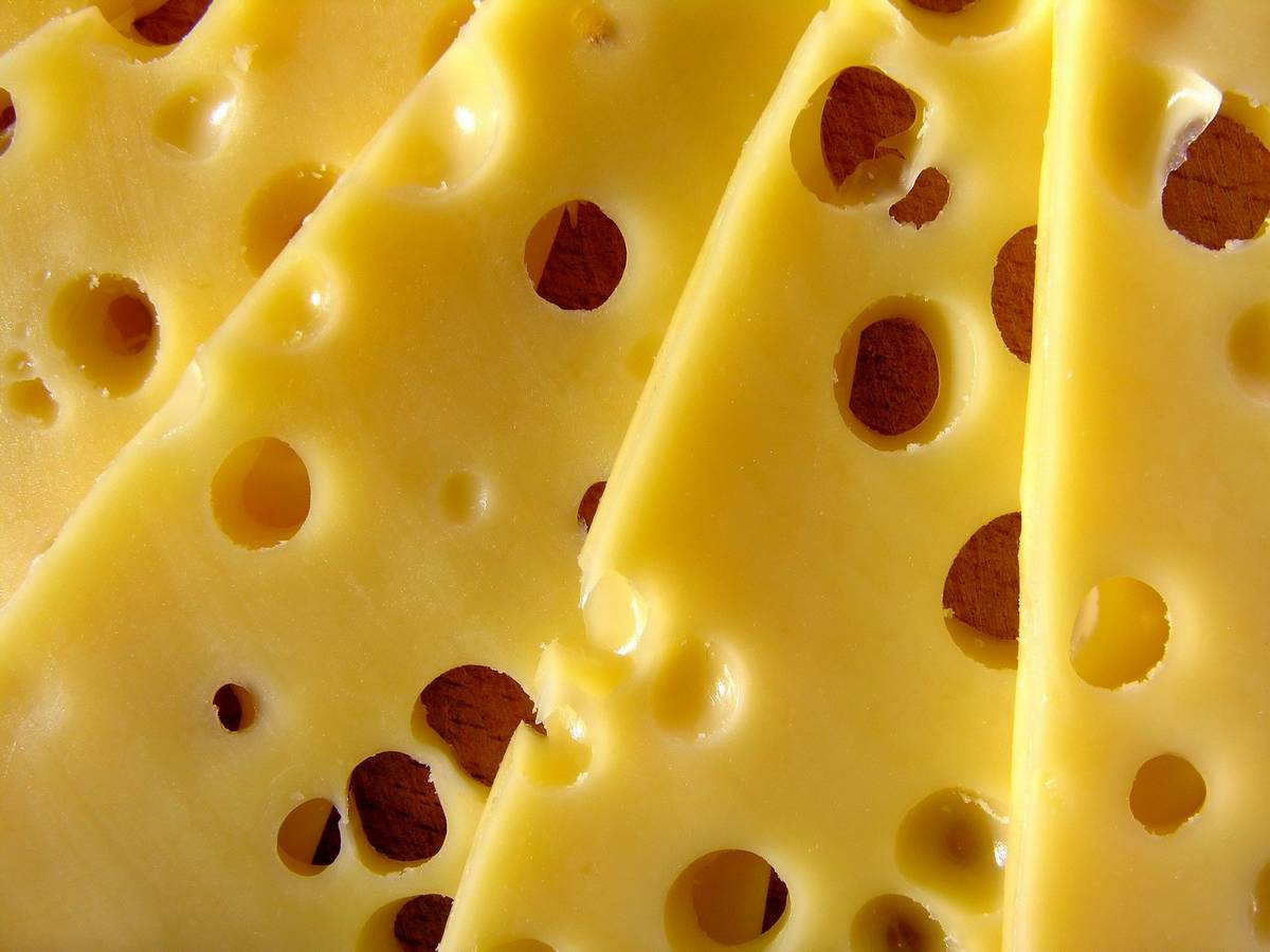 A close up of yellow holey cheese. A personal trainer's guide to food, diets and nutrition
