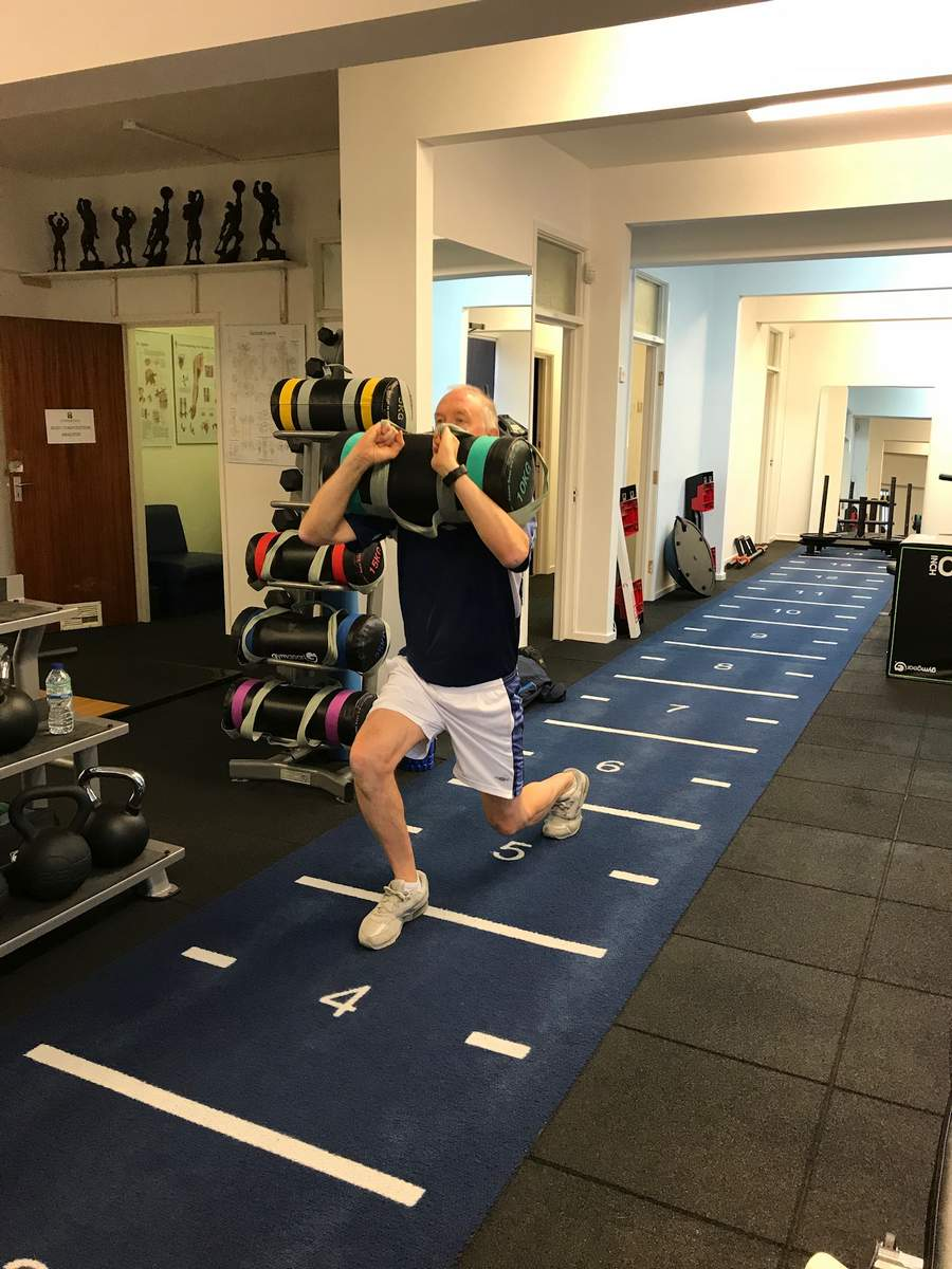 Power bag front loaded lunges. Private personal training studio.