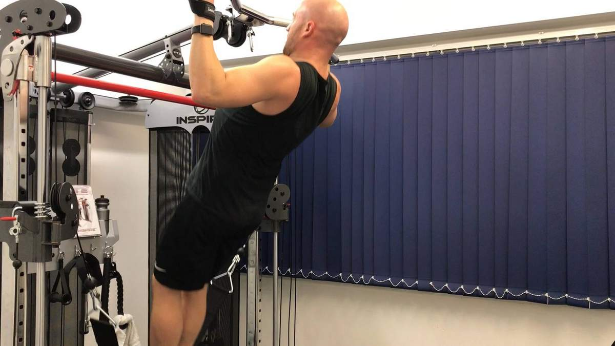 Assisted pull up on the FT2. Private personal training studio.