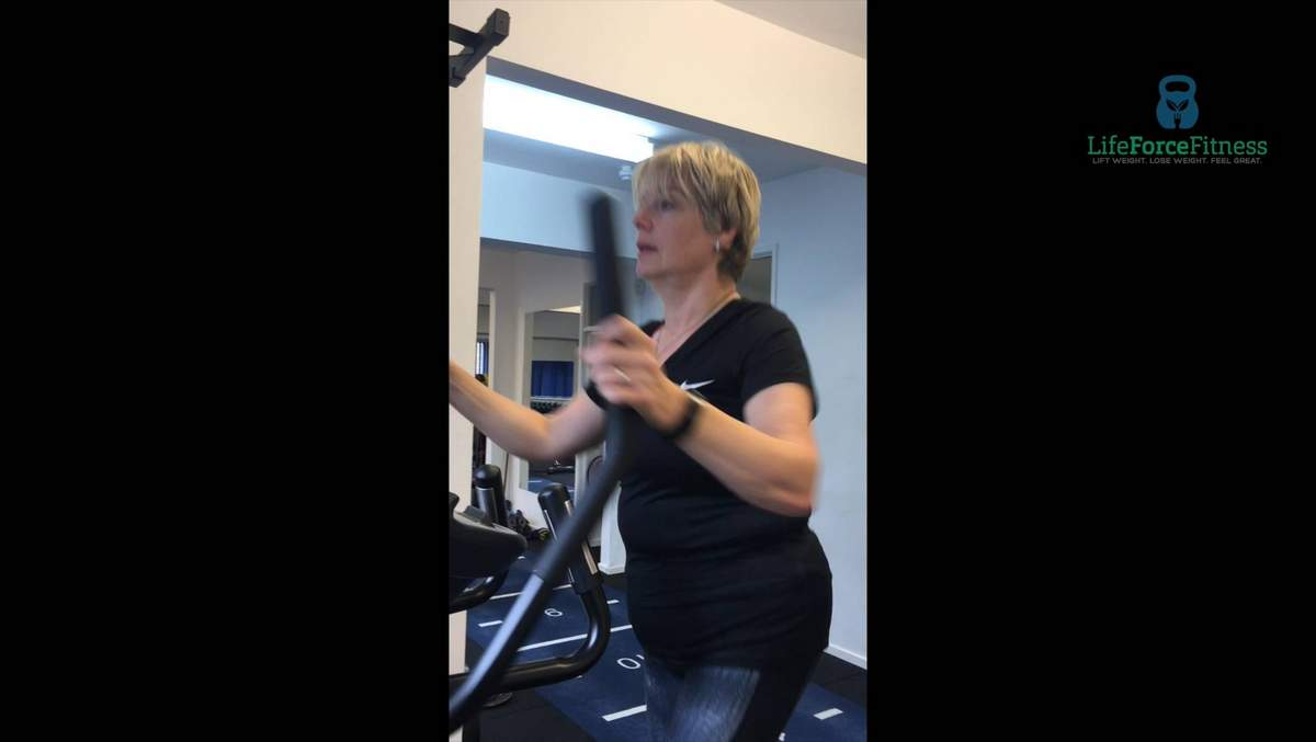 Client on the cross trainer
