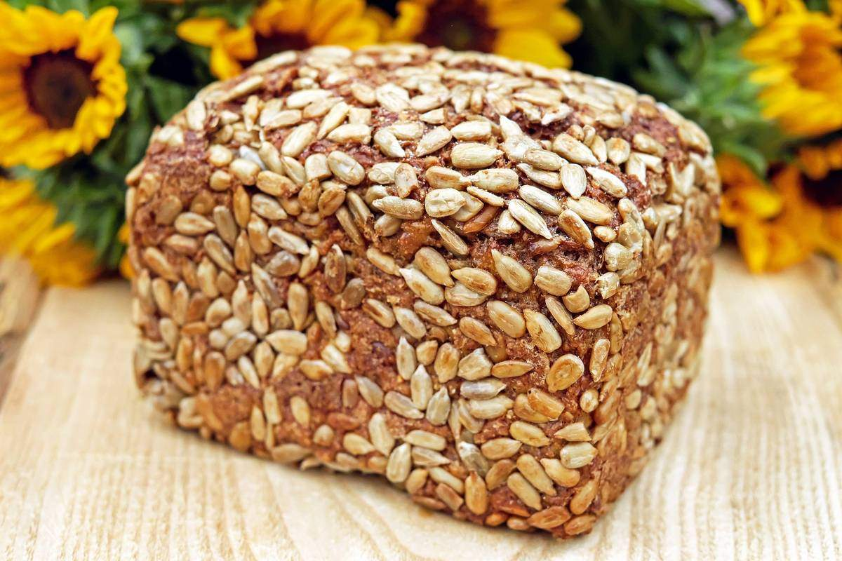 A healthy wholegrain loaf covered in seeds and grain kernels. Wholegrain is the best choice for fuelling your sport
