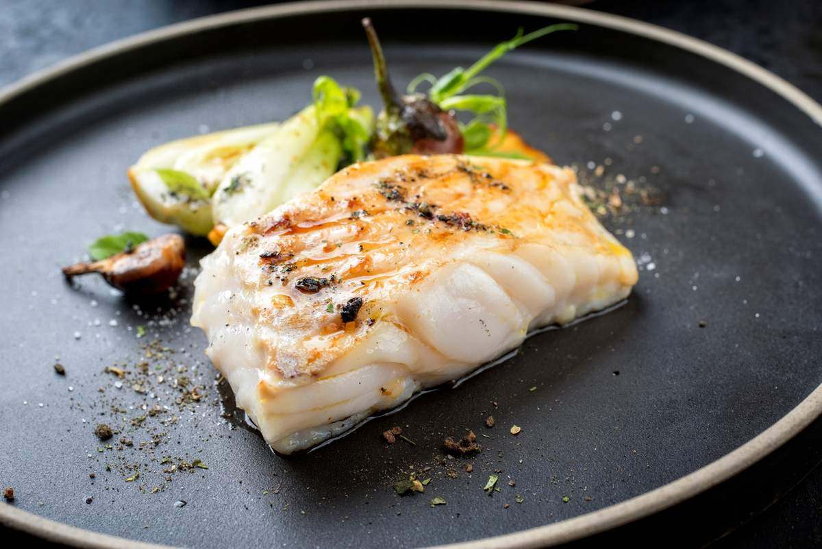 Piece of fish on a plate. Eating to build muscle