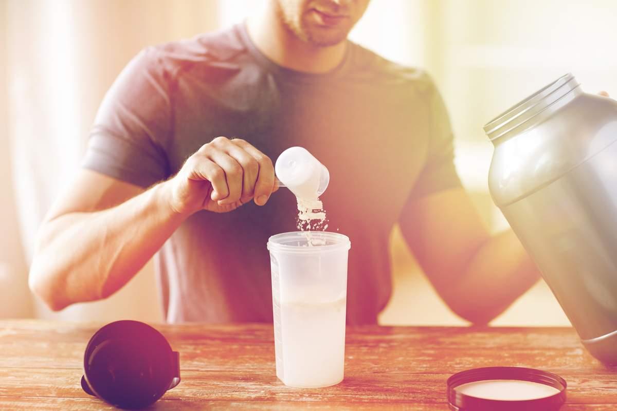 Man preparing a whey shake.