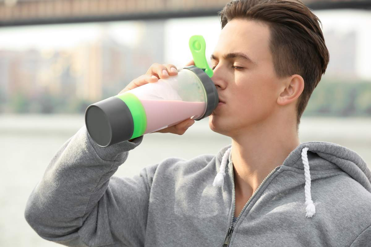 Man drinking a whey shake. Eating to build muscle