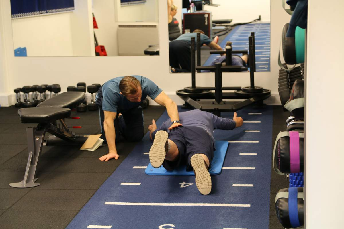 Personal trainer supervising a client. The safest personal training venue in Northampton