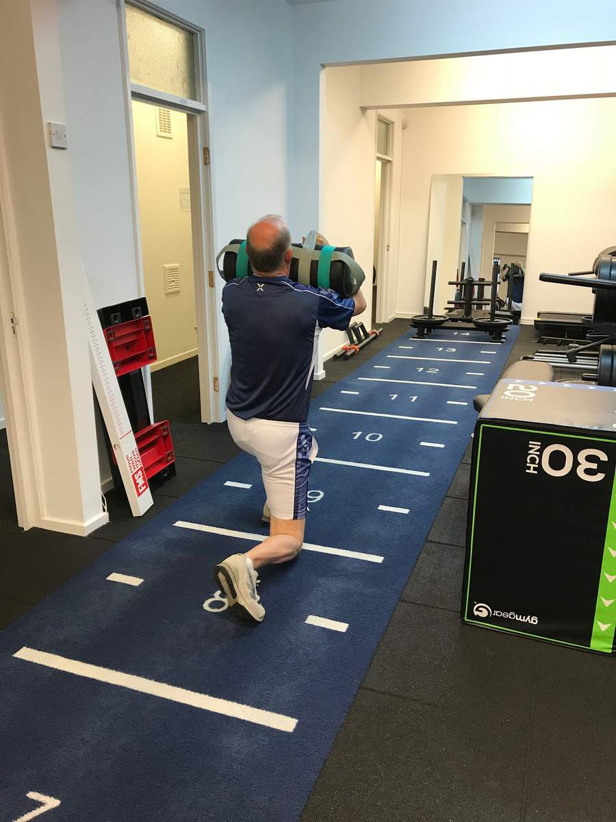 Client performing walking lunges at the Life Force Fitness studio. The safest personal training venue in Northampton