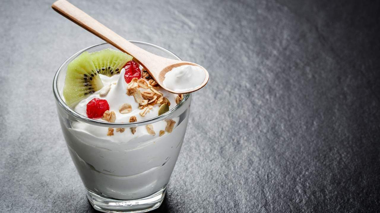 Fruit and yoghurt in a glass. Prioritise protein for weight loss success.