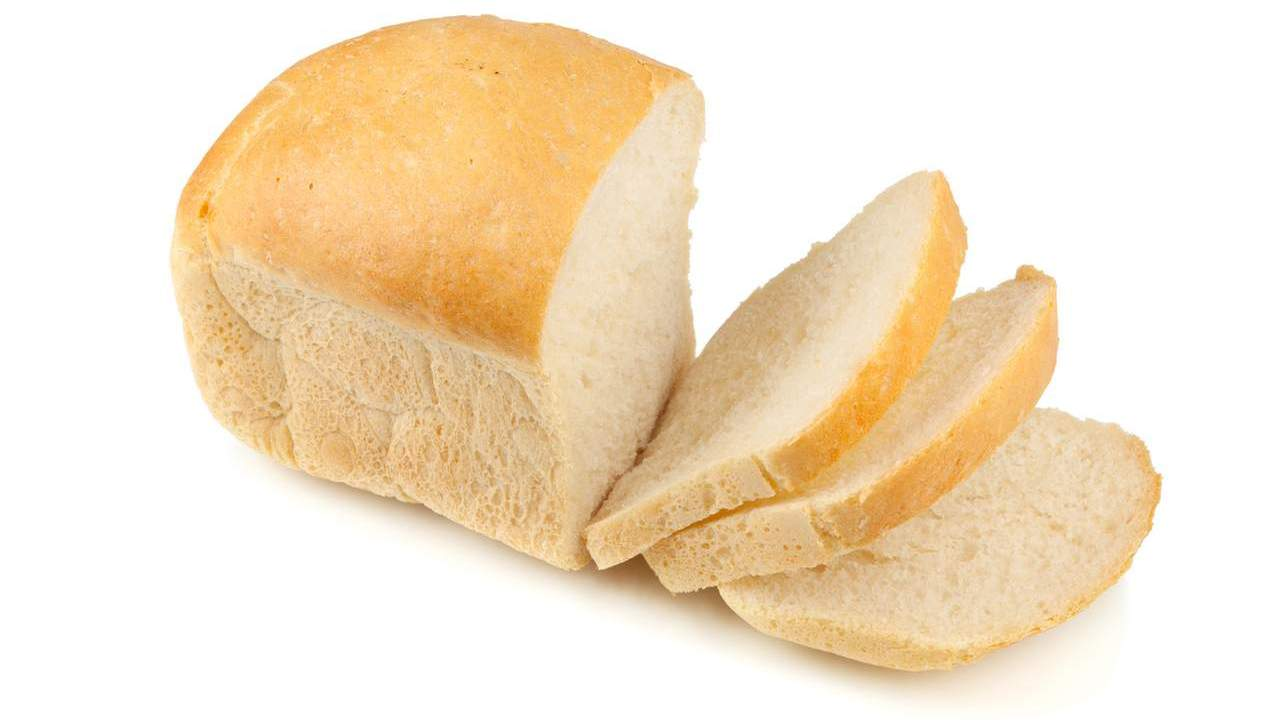 White bread loaf and slices.